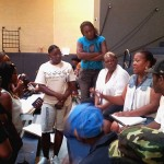 Small group brainstorming session at a PB TIF neighborhood assembly. Photo by Thea Crum