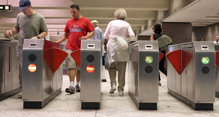 Bay Area Rapid Transit (BART) customers pass through a fare gate at the Embarcadero station in San Francisco, California. Justin Sullivan/Getty Images