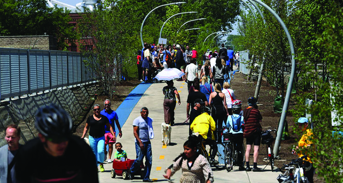 Nancy Stone, Chicago Tribune - The 606 trail in Chicago is filled with people on opening day, June 6, 2015.