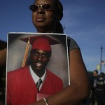 Mother's love: Tonya Burch holds a photo last month of her son Deontae Smith, who was killed in Chicago. Getty Images