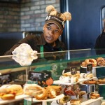 Hagar Johnson, center, a Starbucks shift supervisor, wipes down the glass of the pastry and foods at the new Englewood Square shopping center in Chicago on Sept. 27, 2016. Starbucks and Whole Foods open Weds Sept. 28 in the new Englewood Square shopping center. Jose M. Osorio / Chicago Tribune