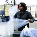 Toni Ross works at Food and Paper Supply Co. on Jan. 27, 2017, in Chicago's Grand Crossing neighborhood. Ross has worked at the food service distributor for 27 years; she was hired through a youth program and is now store manager. The business' co-owner is slated to speak at a forum on youth unemployment Jan. 30, 2017. (Phil Velasquez / Chicago Tribune)