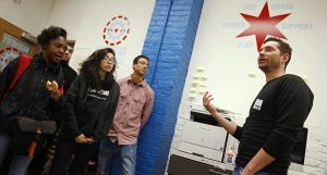 Yolobe co-founder David Douglas (right) speaks to Schurz High School students as part of a pilot program to test Yolobe in Chicago, February 17, 2017. (Jim Young / Chicago Tribune)